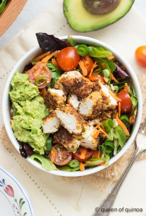 A simple salad topped with crispy #quinoa chicken - perfect for game day!