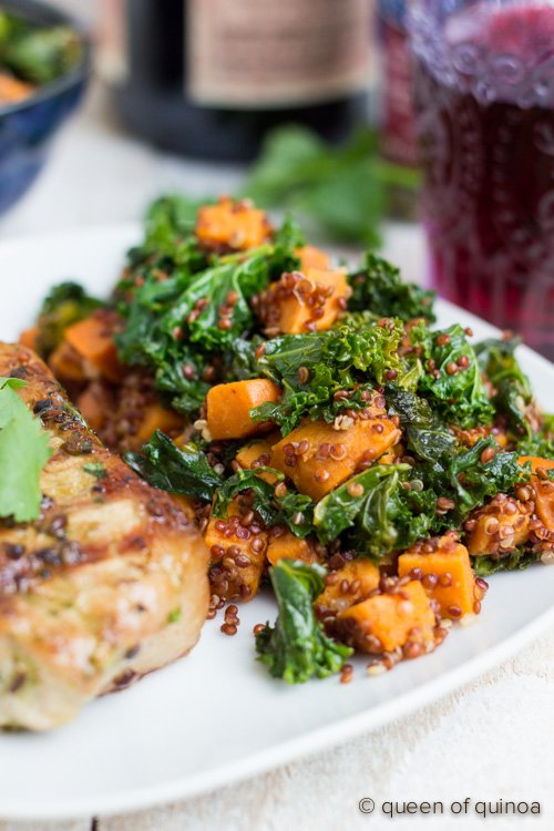 A simple grilled pork chop recipe served with a warm sweet potato, kale and red quinoa salad.