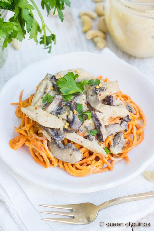 Chicken & Mushrooms served over low-carb sweet potato noodles in a creamy, vegan alfredo sauce (thickened with quinoa)