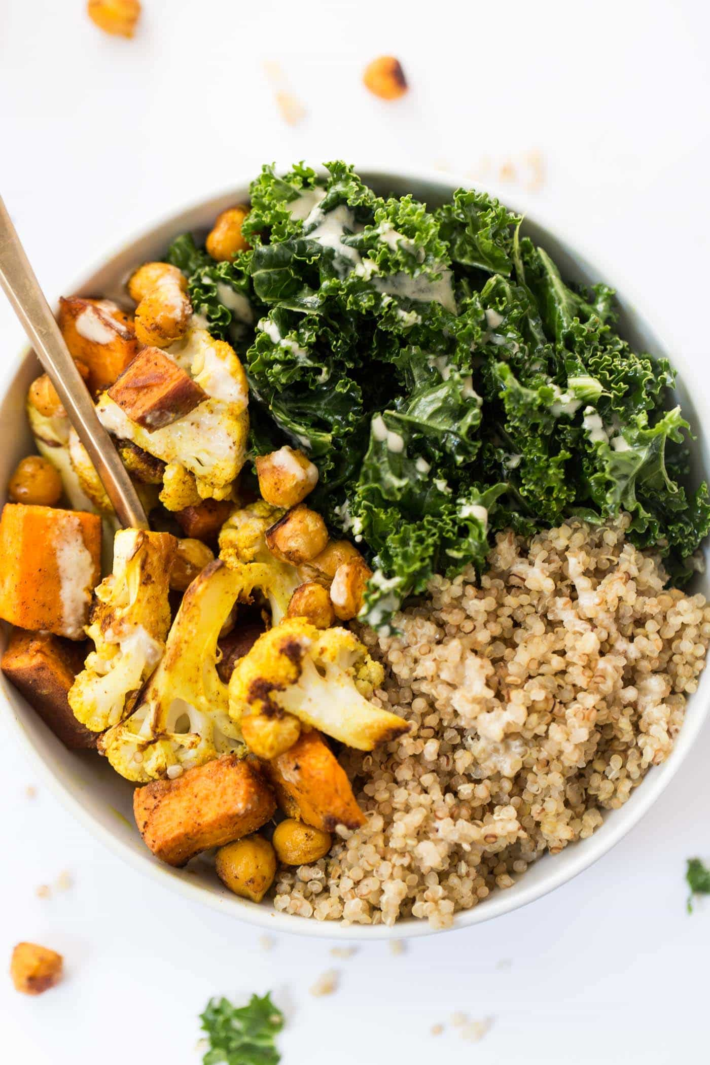 curried roasted vegetable quinoa bowl recipe with creamy tahini dressing