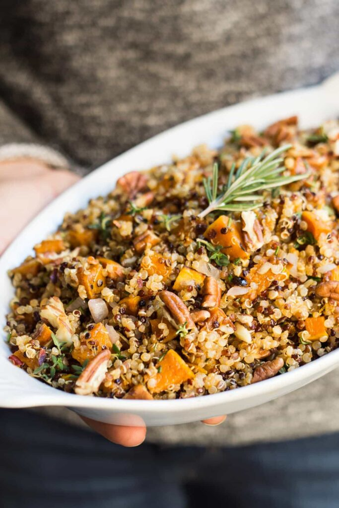 Looking for a healthy Thanksgiving recipe? Give this Easy Quinoa Stuffing a try! Simple to make, packed with flavor and naturally GF & vegan!