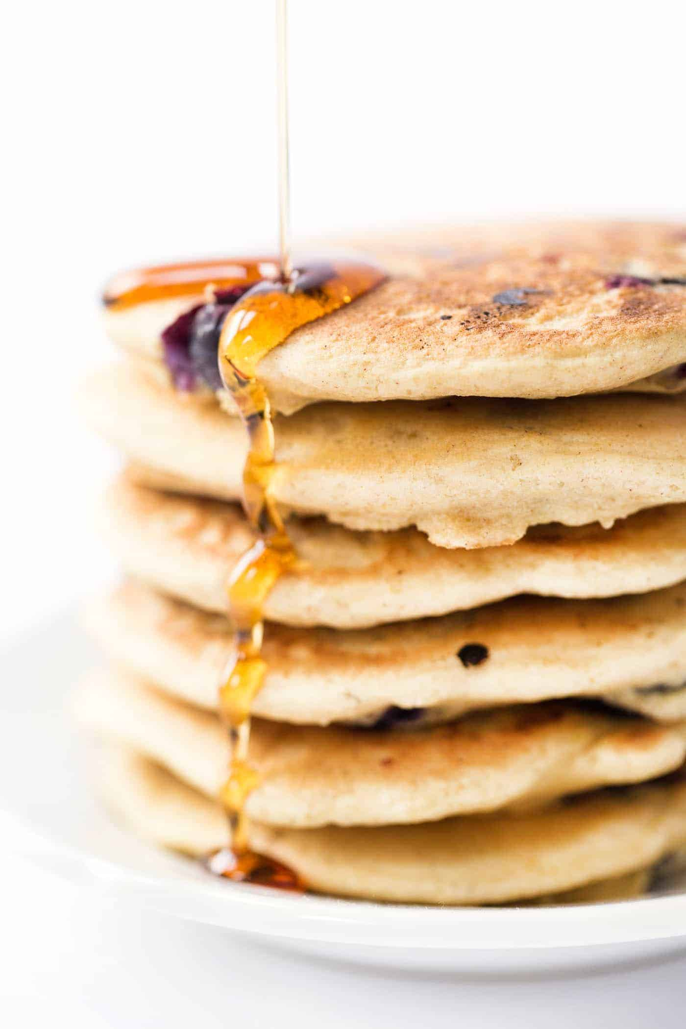 Simply PERFECT gluten-free Blueberry Pancakes made with quinoa flakes! Light, fluffy and surprisingly healthy too!