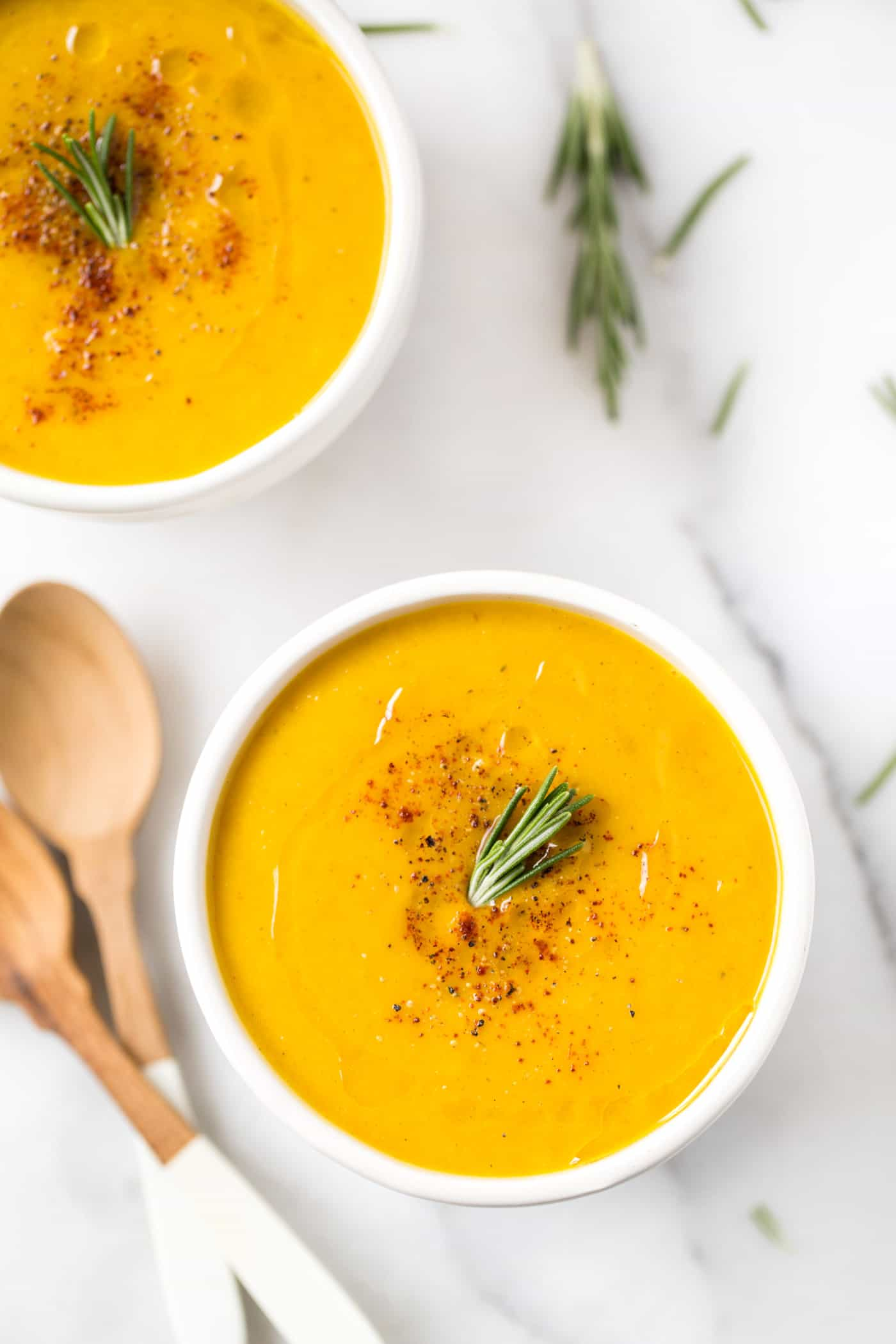 Butternut Squash + Apple Soup -- made with roasted vegetables, rosemary, cinnamon and a ton of other spices! [VEGAN]