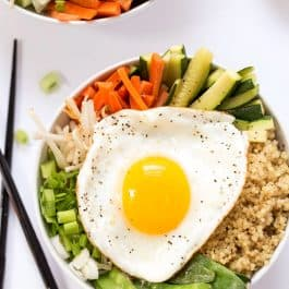 This simple Quinoa Bibimbap is made with steamed veggies and topped with a fried egg for an easy, delicious and meatless meal!