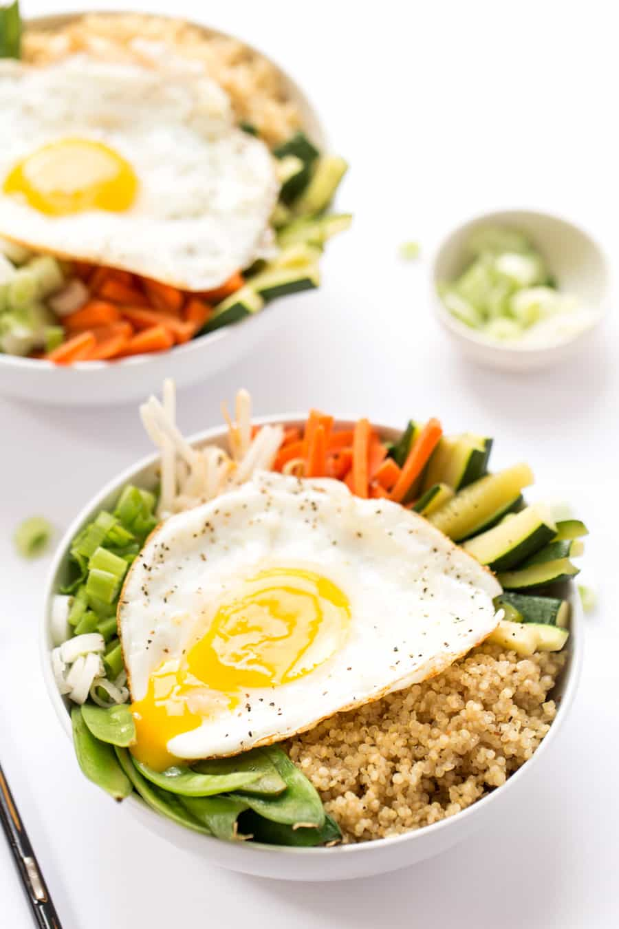 A healthy spin on this Korean staple, this QUINOA BIBIMBAP, made with fluffy quinoa, steamed vegetables and a fried egg, is a great alternative to takeout!