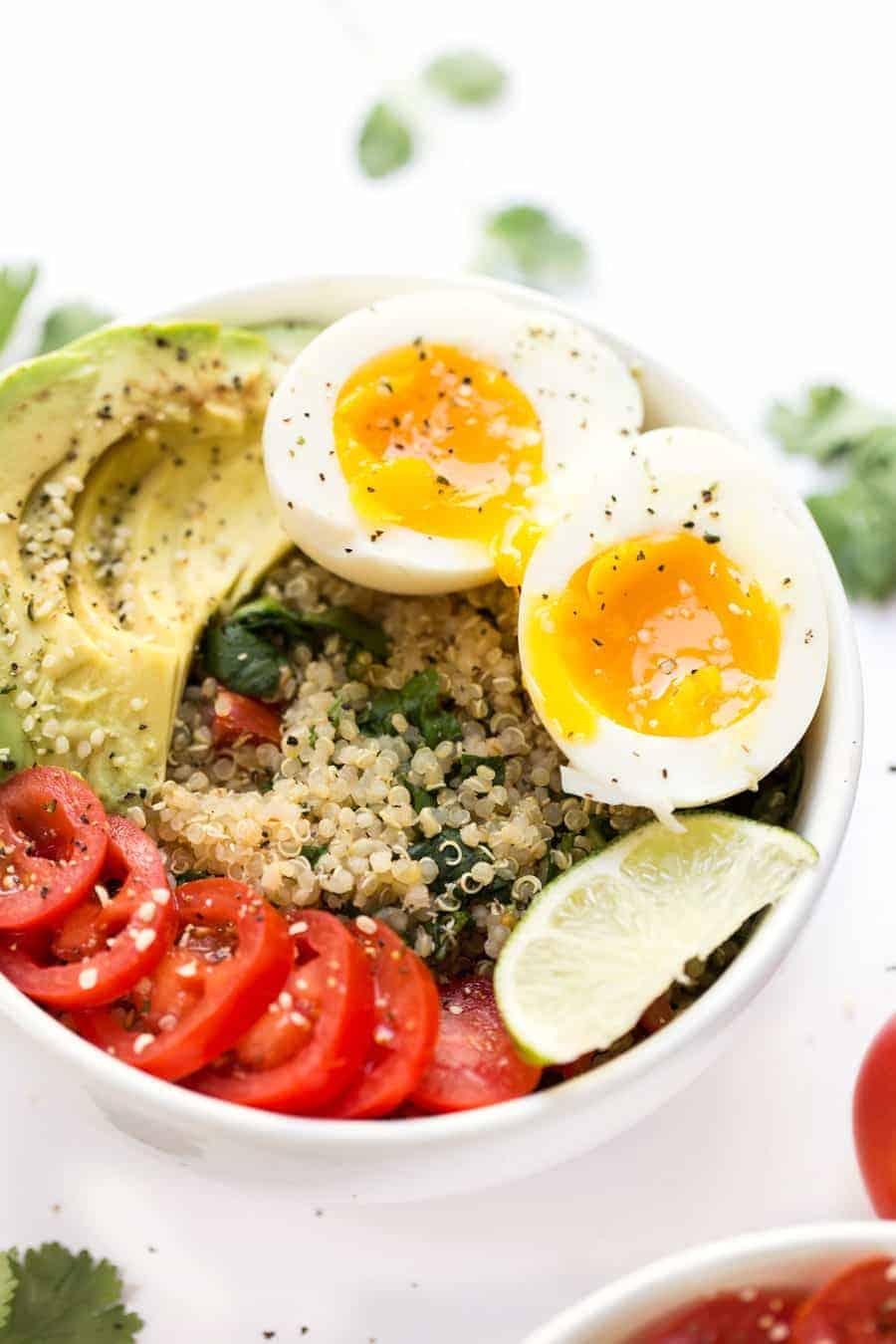 Mexican Quinoa Breakfast Bowls -- with tomato, avocado, soft boiled eggs and cilantro-lime quinoa!