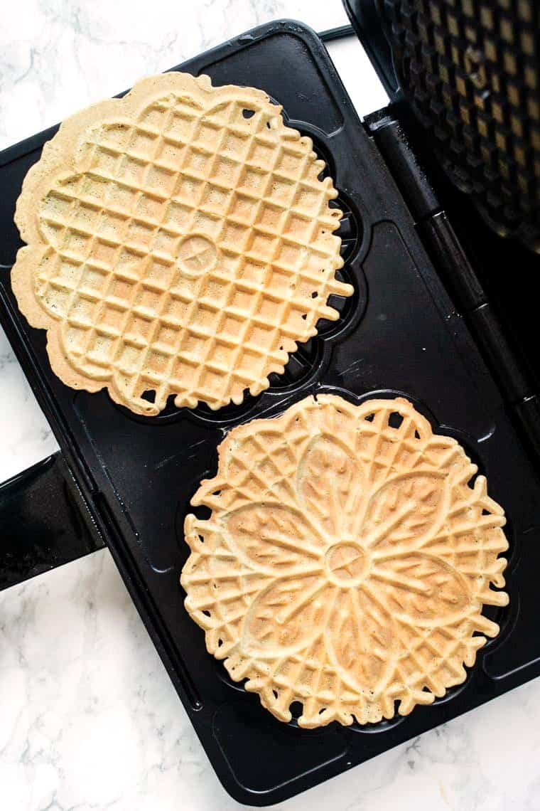Pizzelles Cooking in Pizzelle Iron
