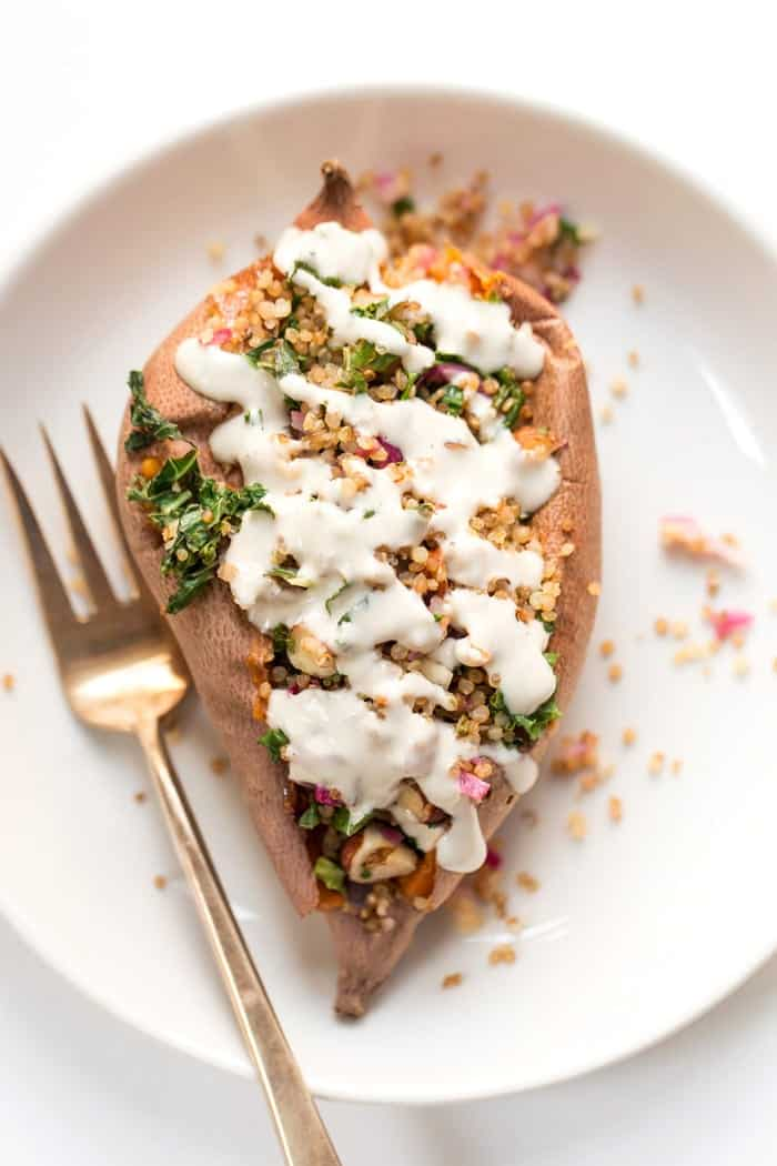 quinoa stuffed sweet potatoes with tahini and kale