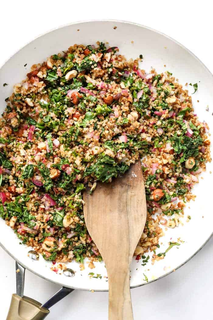a kale and quinoa salad with lemon, onion and hazelnuts