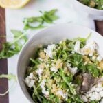 Warm Arugula Salad with Quinoa & Goat Cheese