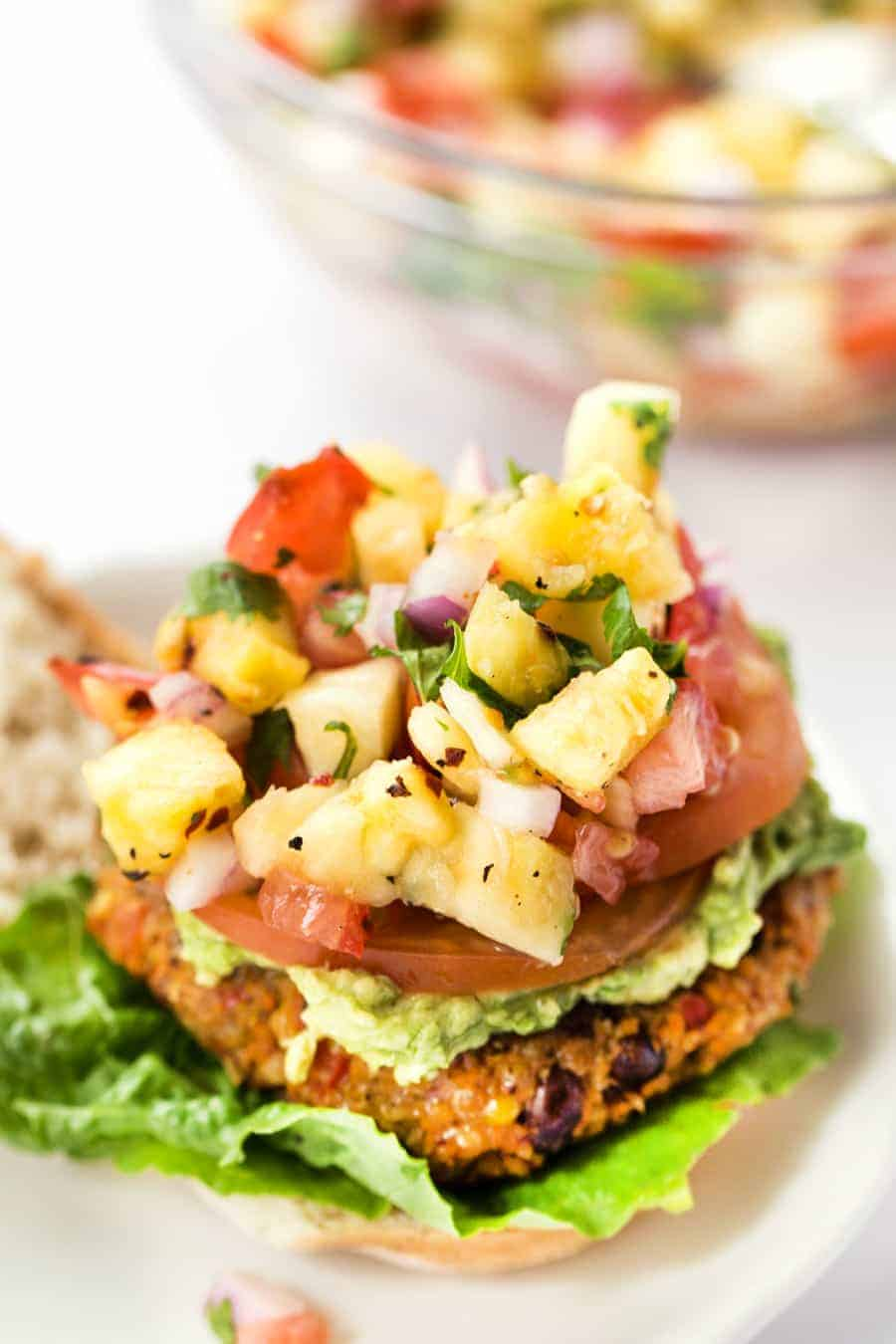 TEX MEX QUINOA BURGERS with corn, black beans and topped with a delicious pineapple salsa!
