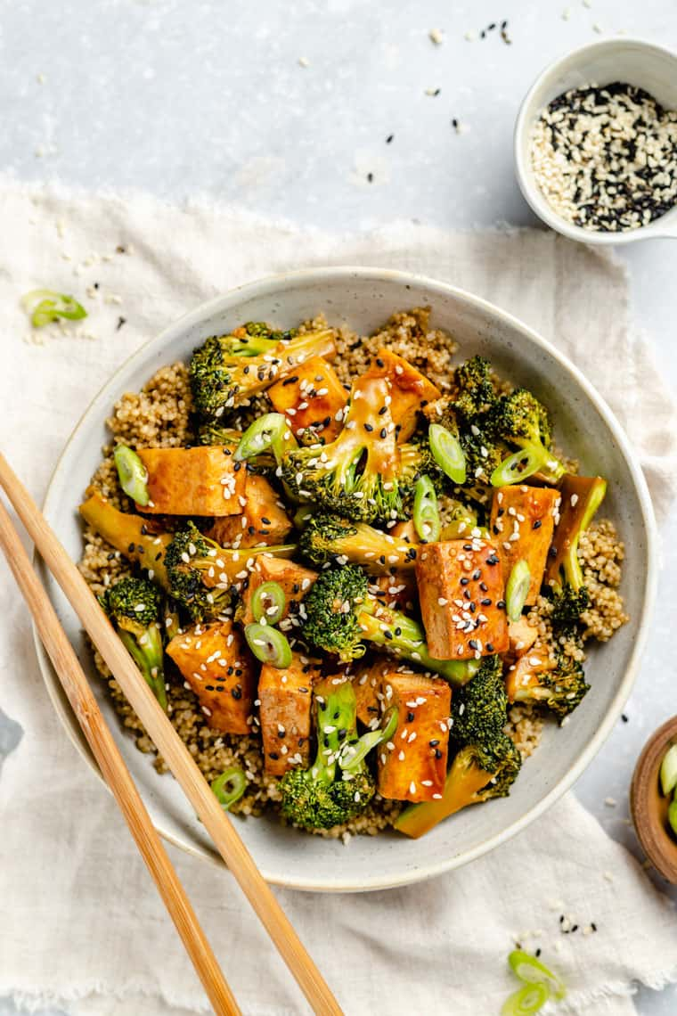 Tofu and broccoli stir fry with quinoa and soy sauce