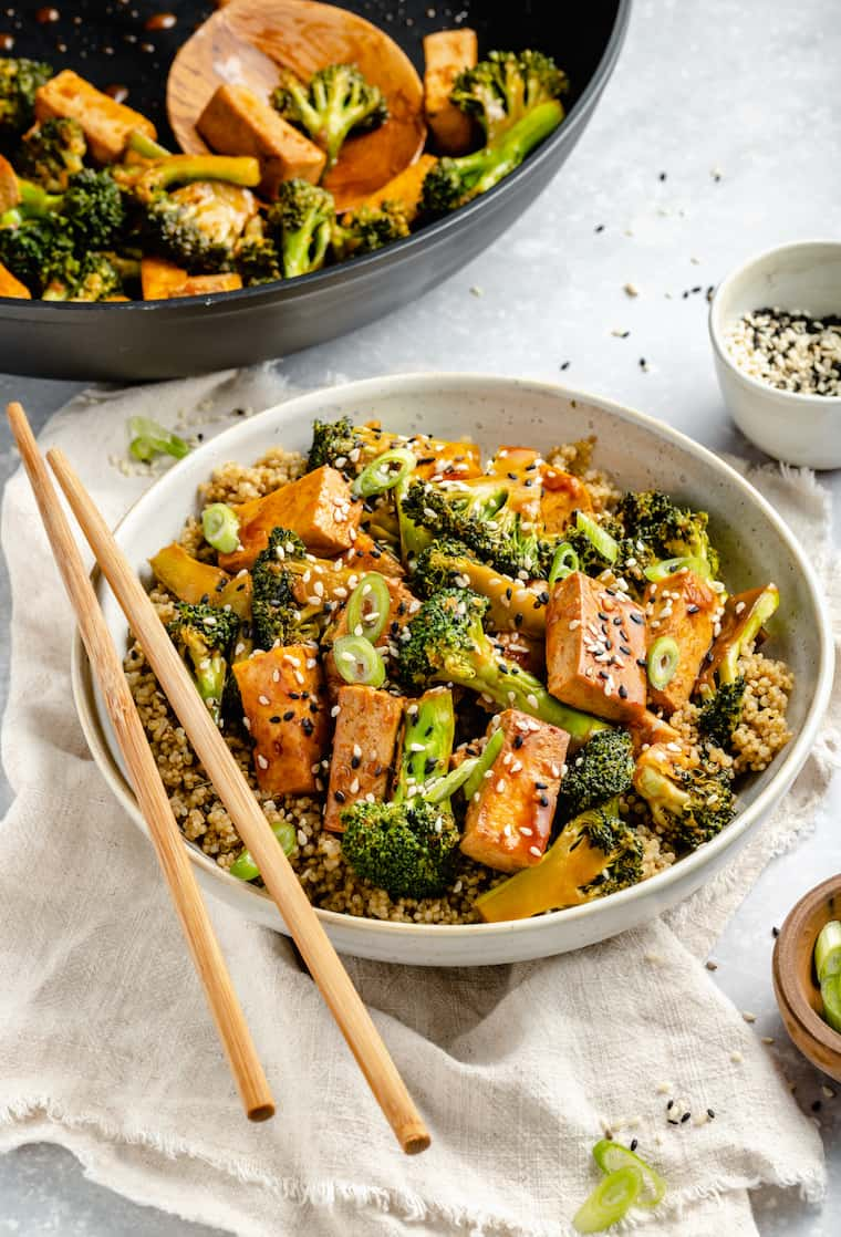 bowl of teriyaki quinoa stir fry with broccoli and tofu