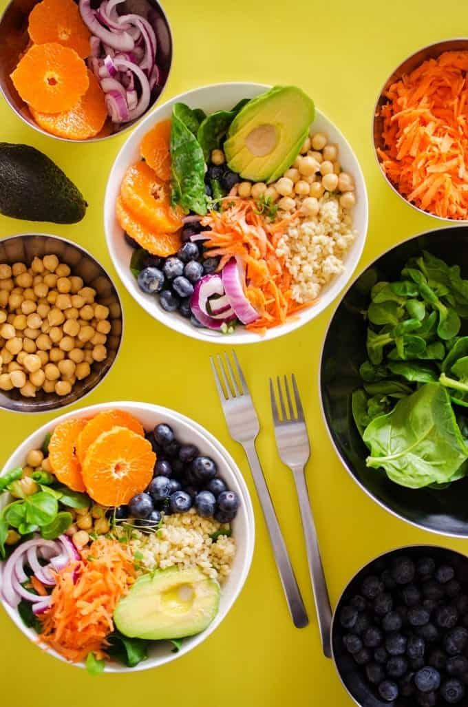 This 15 Minute Buddha Bowl recipe is a balanced, healthy lunch or dinner meal that comes together in no time! It's a flavorful combo of healthy grains (bulgur, quinoa, couscous, or brown rice), chickpeas, fruit and avocado with a creamy, citrusy yogurt salad dressing.
