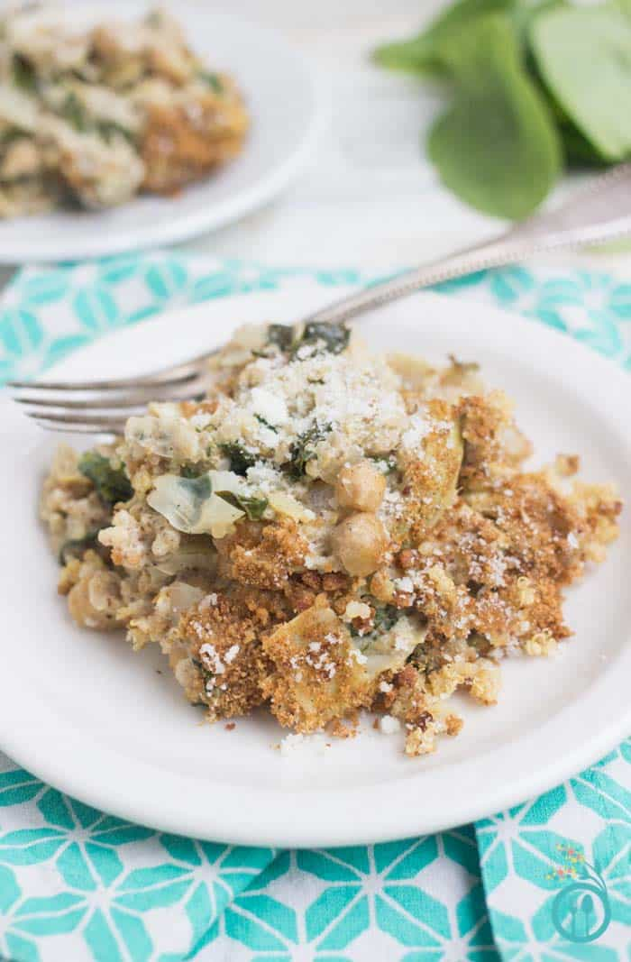 A healthy QUINOA CASSEROLE made with spinach, artichokes & chickpeas