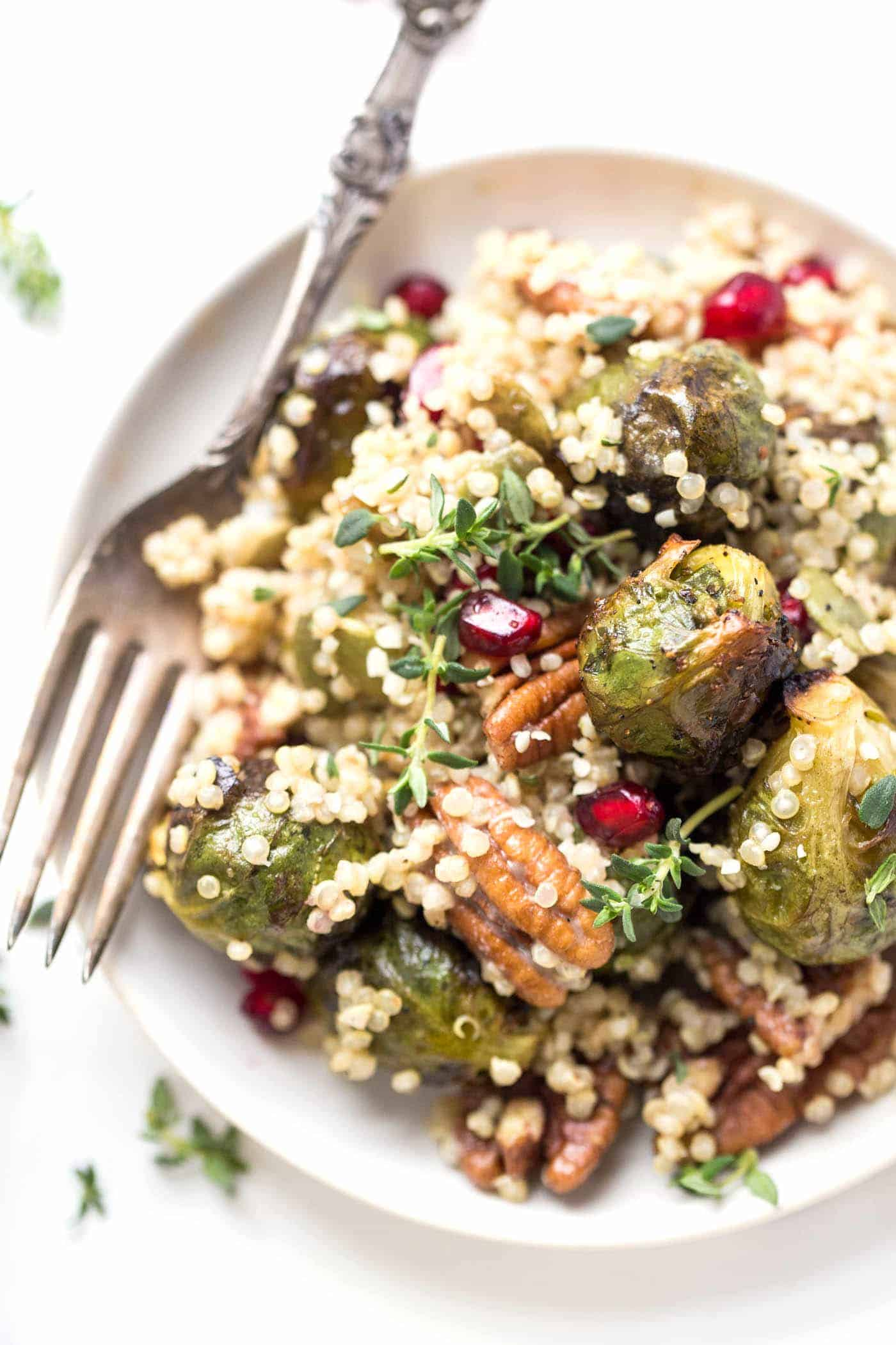 Roasted Brussels Sprout Quinoa Salad with pomegranates, pecans and a bright, tangy dressing!