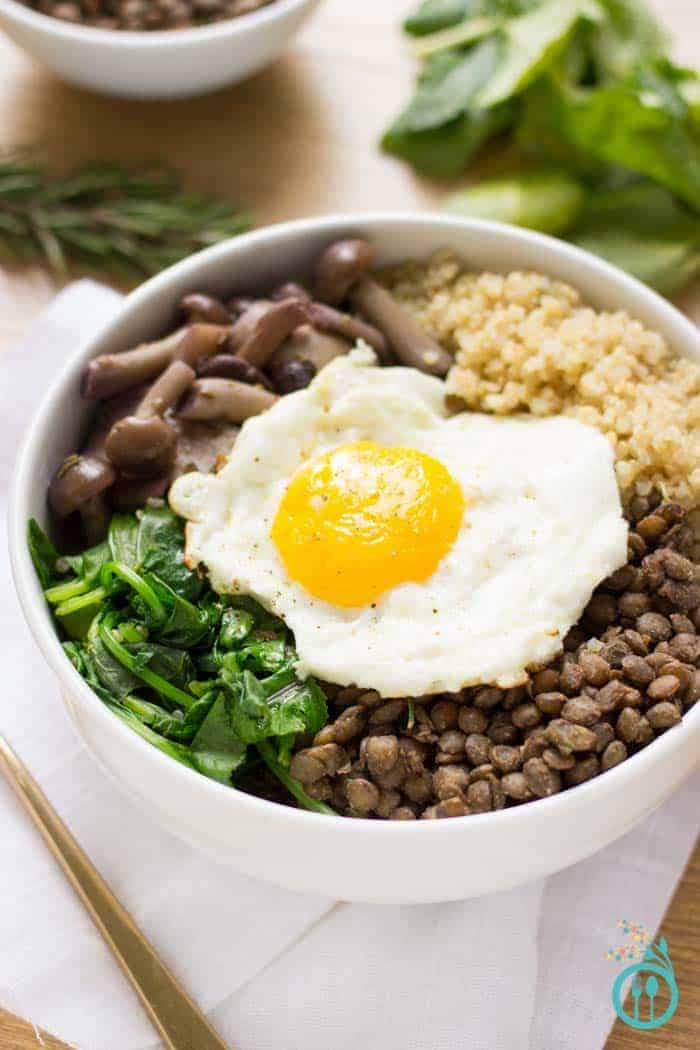 A warm and comforting QUINOA BOWL with hearty French Lentils and flavor packed mushrooms. All topped with a perfect fried egg on top!