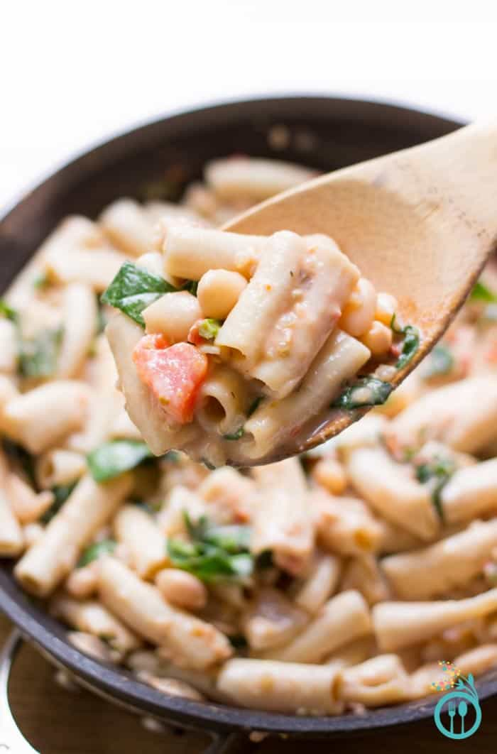 This Rustic Tuscan White Bean Pasta is tossed with a dreamy tomato-cream sauce made from only 3 simple ingredients!