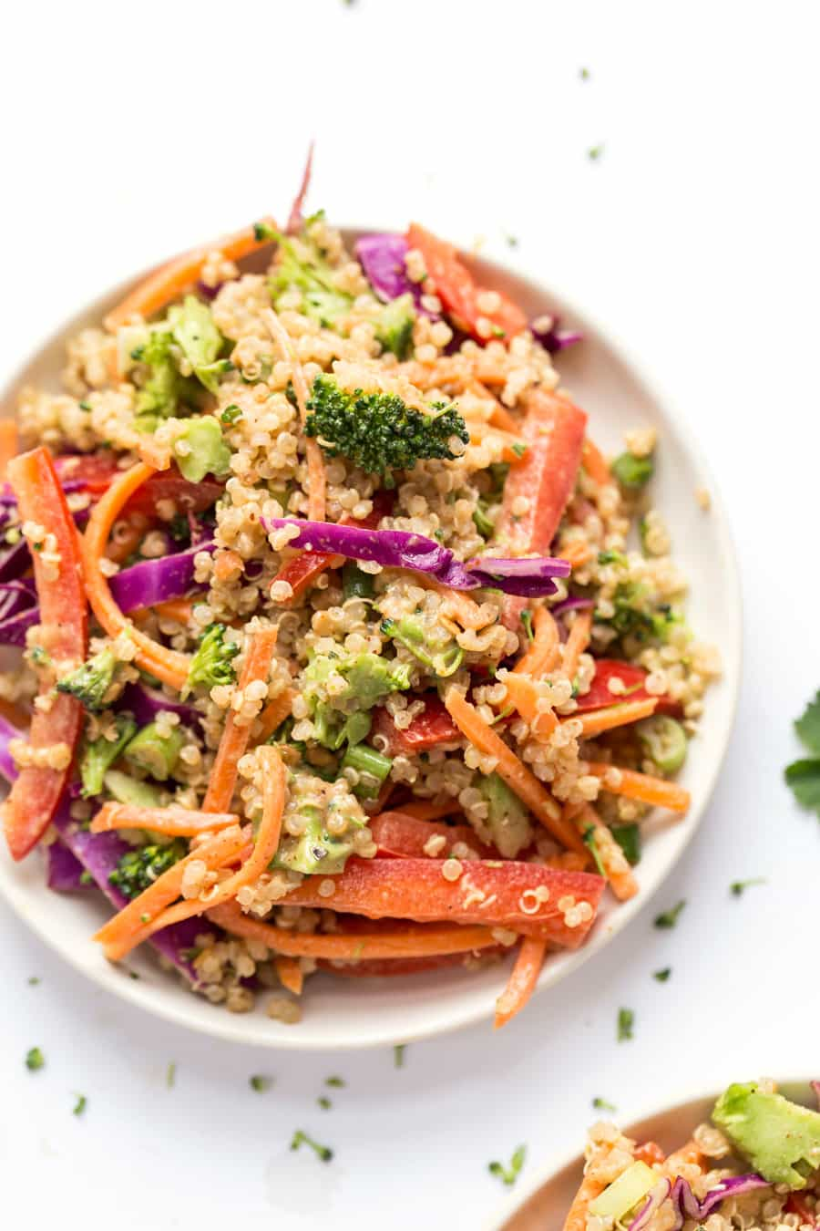 This simple THAI QUINOA SALAD is peppered with a rainbow of veggies and tossed in a creamy almond butter sauce! Tastes like pad thai, but in salad form!
