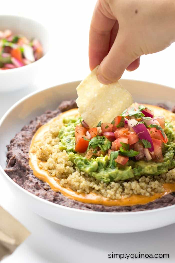 healthy and vegan refried bean dip with vegan queso