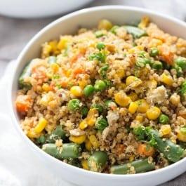 Super Easy Vegetable Quinoa Fried Rice that's made in less than 10 minutes and uses only 8 ingredients! (it's also gluten-free + vegetarian)