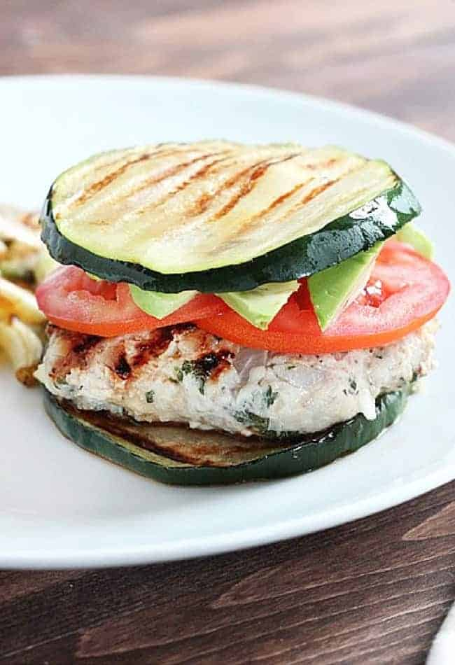 Herbed Turkey Burgers served with grilled zucchini buns. And if you don't have zucchini, use eggplant!