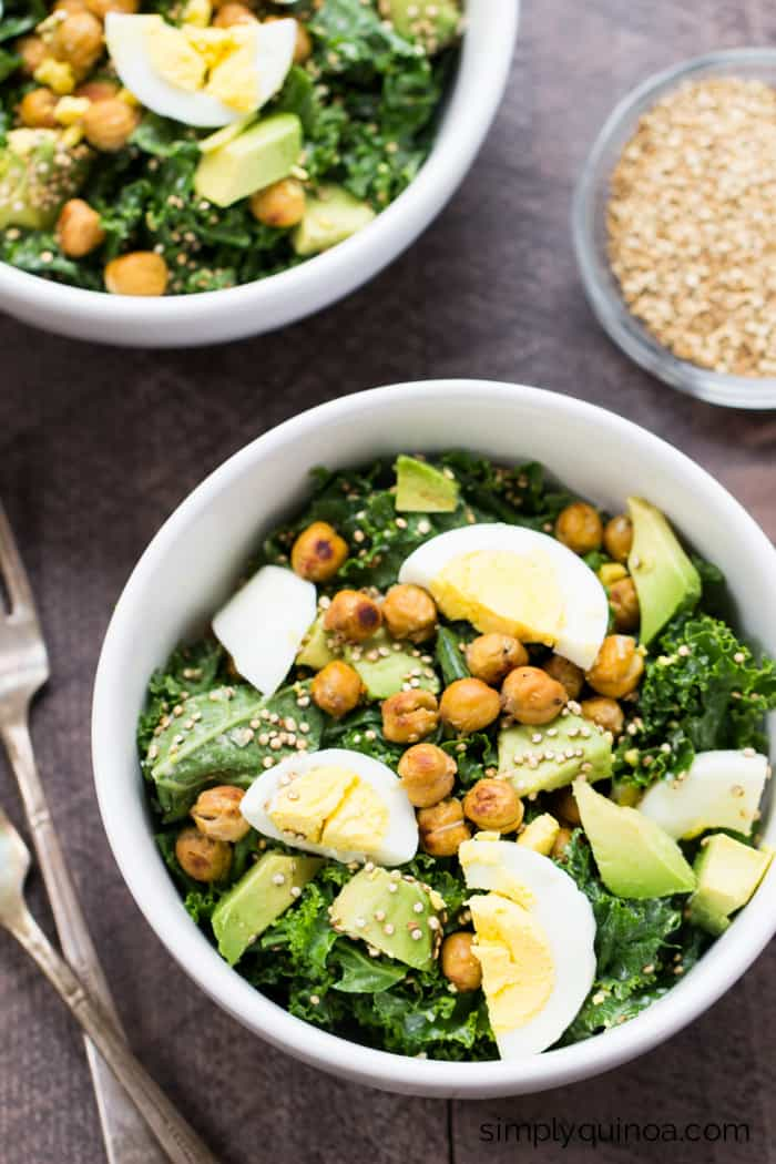 The best damn kale salad on the planet! Tossed with a lemon-garlic tahini dressing and topped with crispy chickpeas, hard boiled egg and toasted quinoa.