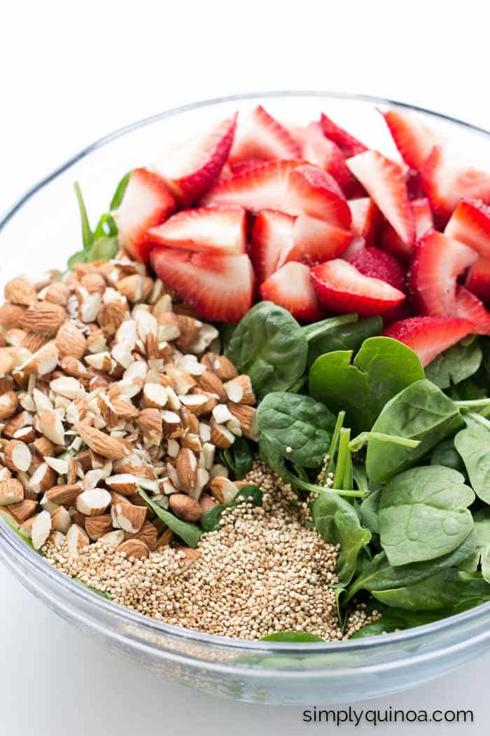 This is the BEST and TASTIEST summertime salad ever! With strawberries, spinach and toasted quinoa is healthy and flavorful!