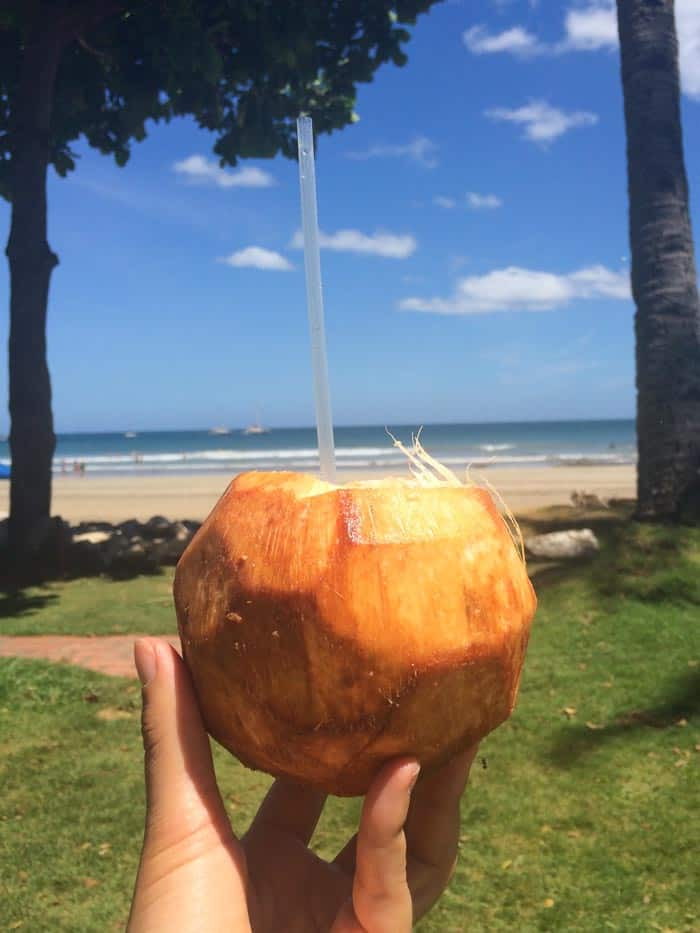 Drinking fresh coconut water in Tamarindo, Costa Rica | www.simplyquinoa.com