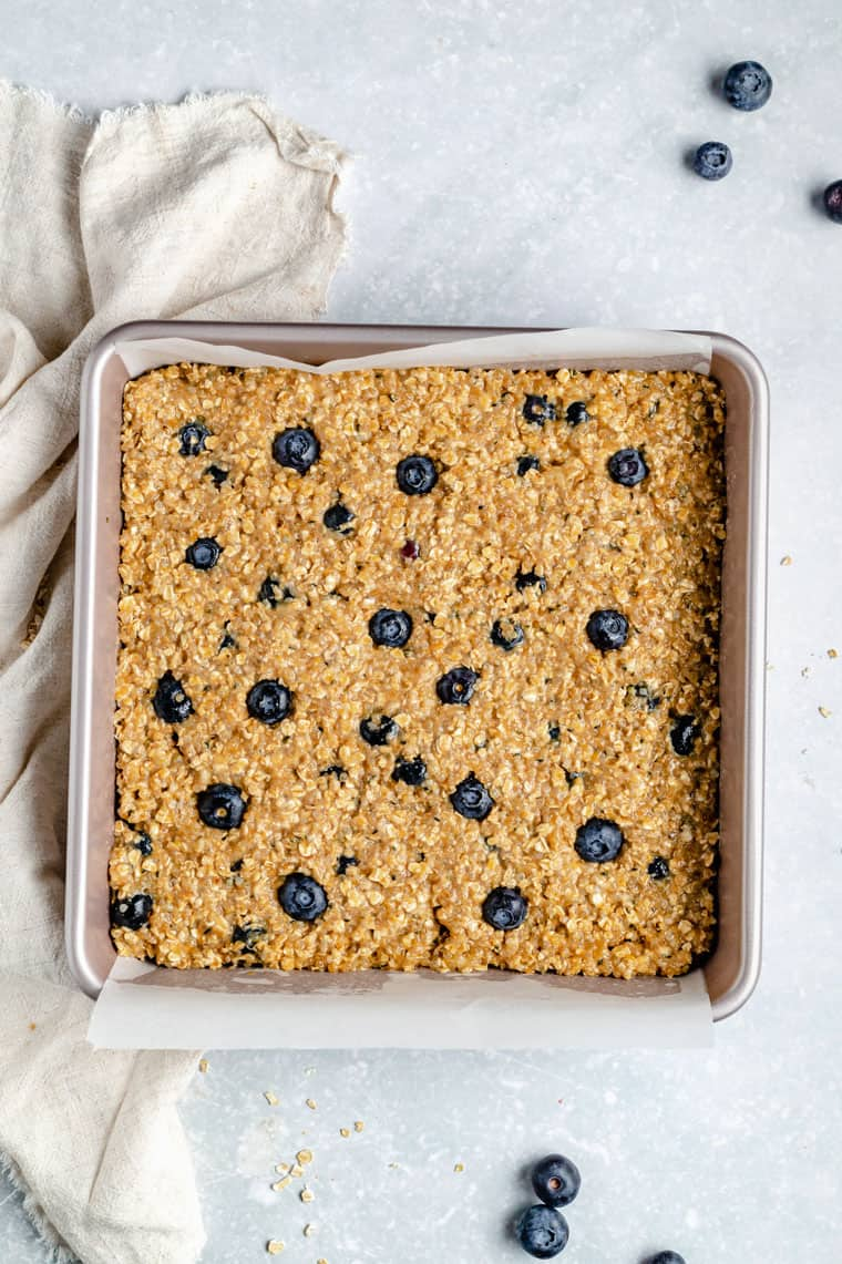 overhead of a baking dish with blueberry quinoa bars after baking
