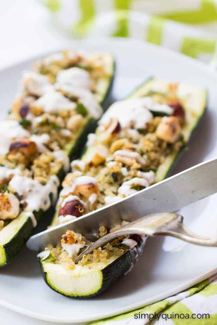 These Quinoa Stuffed Zucchini Boats are a SIMPLE and delicious weeknight meal | recipe on simplyquinoa.com