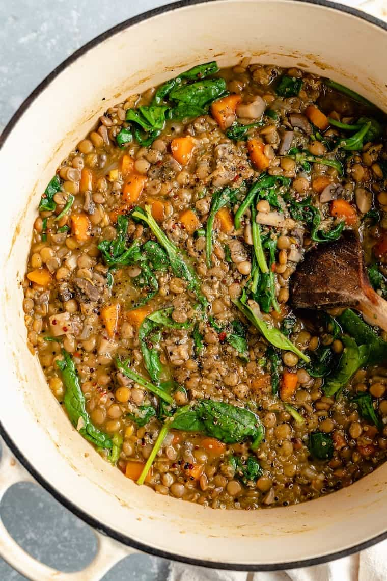 healthy lentil recipe in a big pot cooking with spinach