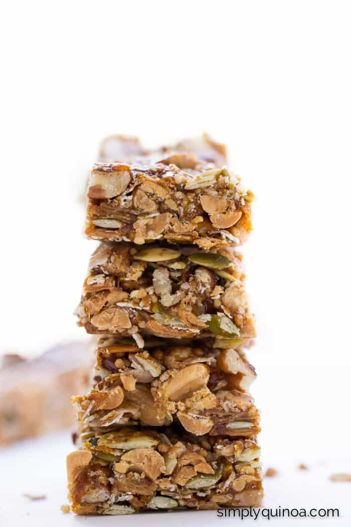 The most AMAZING granola bars ever made with nuts, seeds, coconut, honey and QUINOA. Plus, they're gluten-free + no-bake too!