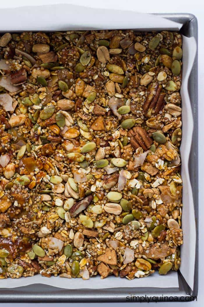A perfect batch of QUINOA granola bars >> made with a blend of nuts, dried apple and coconut and sweetened with an amazing honey caramel