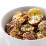 Roasted Potato + Red Quinoa Salad tossed in a shallot, caper + lemon dressing!