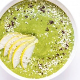 Caramel Cashew Green Smoothie bowl topped with sliced pears, hemp seeds, quinoa flakes and vanilla powder -- it tastes like you're eating a bowl of ice cream for breakfast, but it's actually good for you!