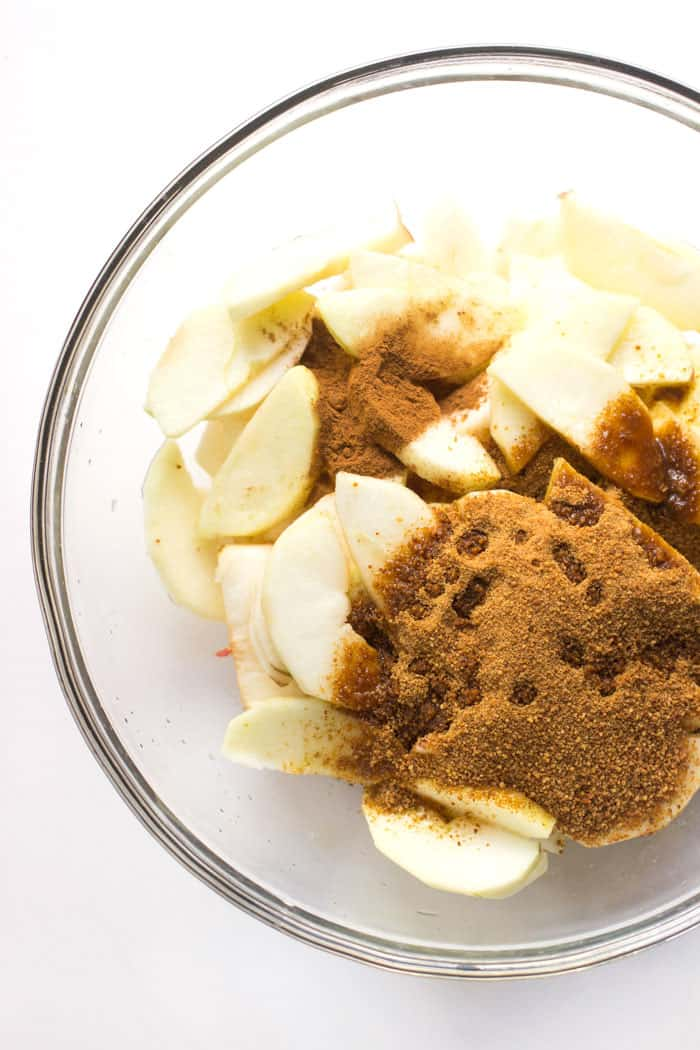 How to make apple crisp in the slow cooker. You start with just four simple ingredients: apples, coconut sugar, cinnamon and lemon juice.