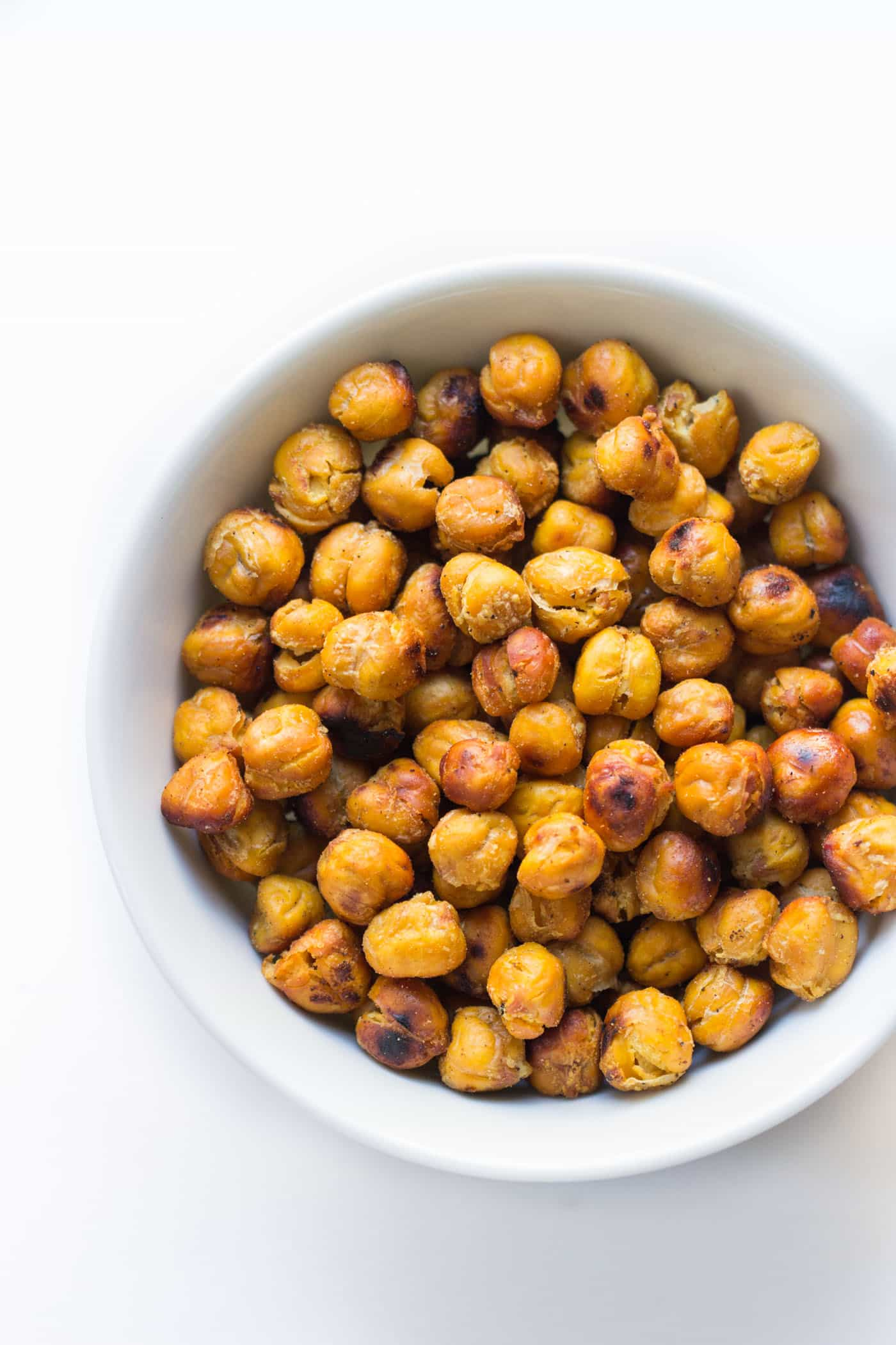 Crispy Garlic Roasted Chickpeas -- awesome on top of salads, soups, as a snack or even on pizza!