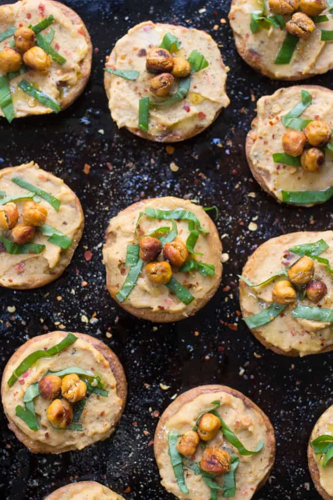 Mini Quinoa Pizza Bites with hummus and crispy chickpeas -- a perfect appetizer that's easy, healthy and packed full of protein! [vegan + gluten-free]