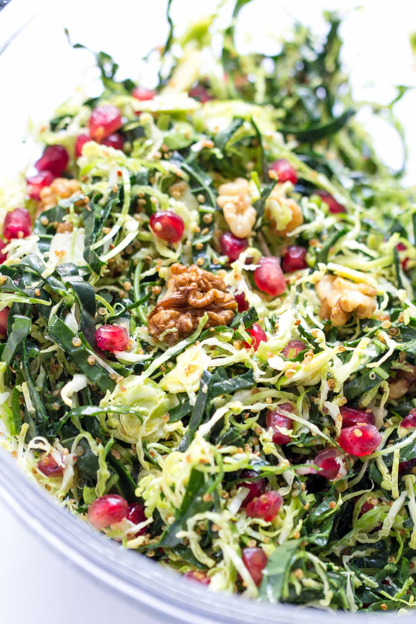 A healthy holiday salad with shredded brussels sprouts, kale, quinoa, walnuts and pomegranates -- it looks so festive and delicious!