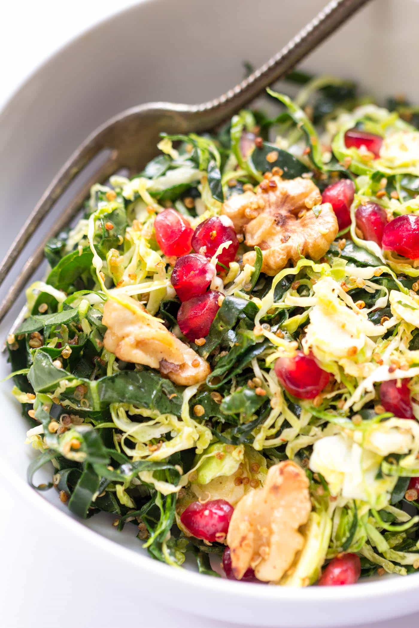 The perfect holiday salad -- Shredded Brussels Sprouts with kale, crispy quinoa, toasted walnuts and pomegranates