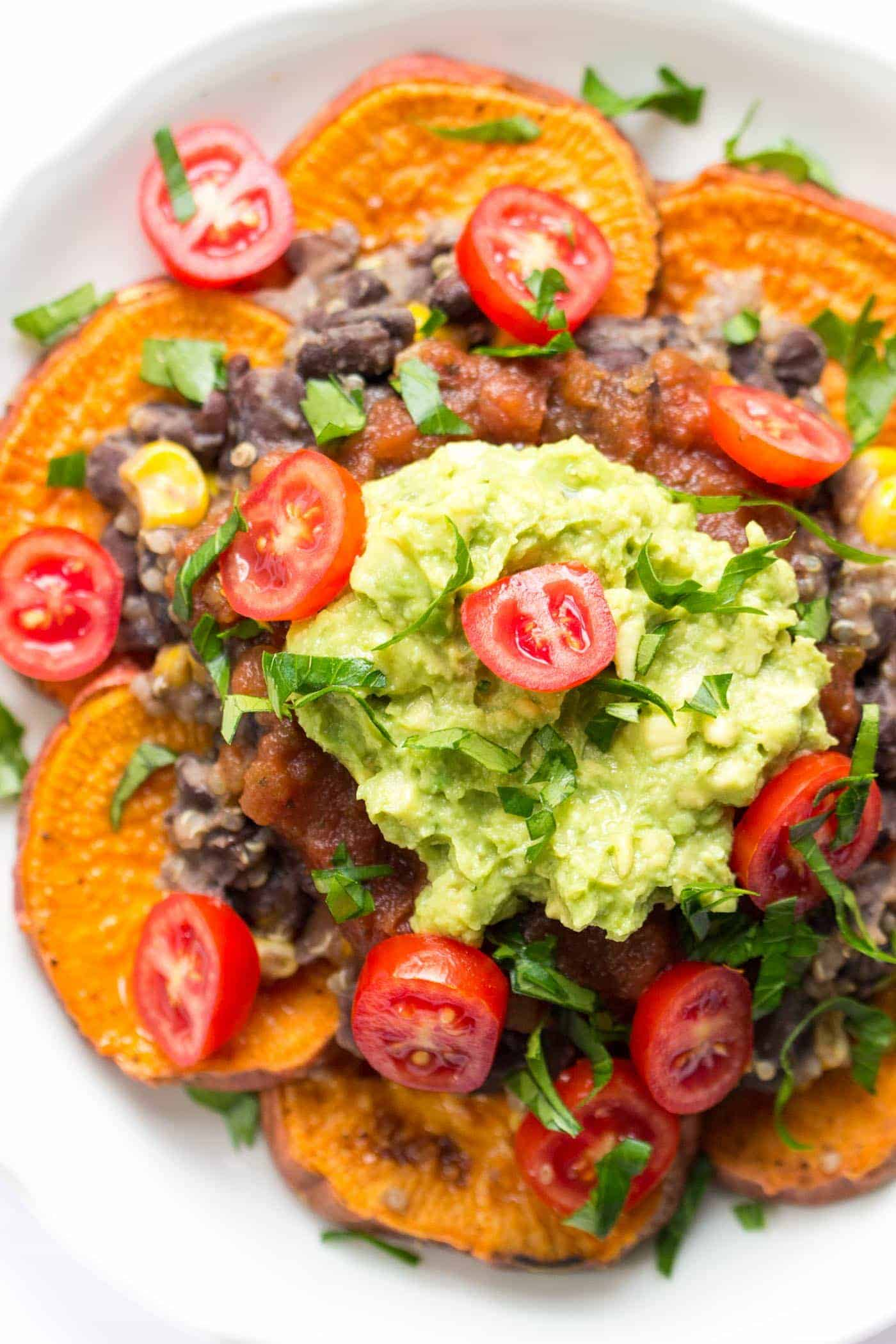 How to make nachos healthy >> swap tortilla chips for sweet potatoes! These quinoa nachos are the bomb!