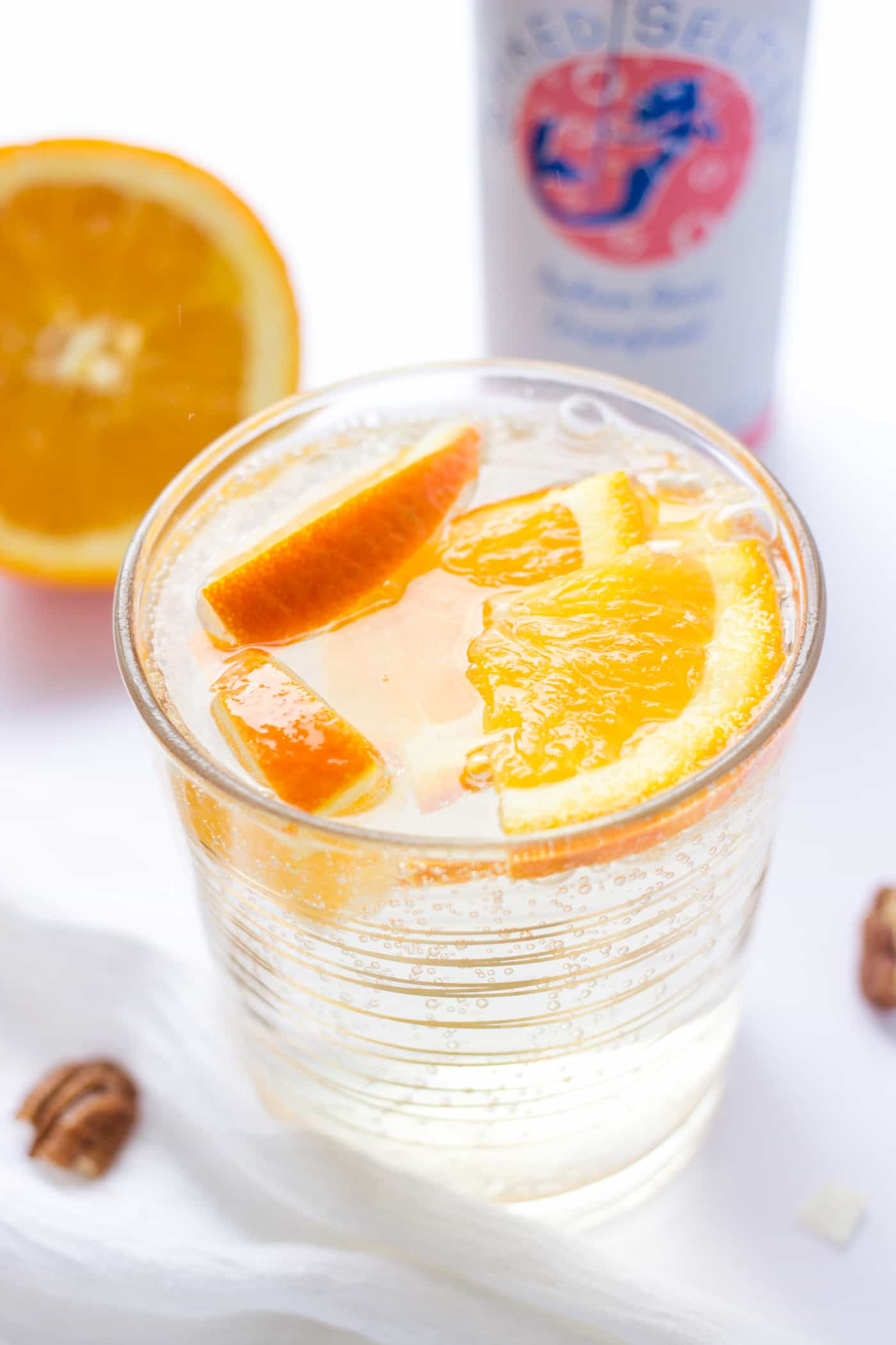 Brunch cocktail recipe with only 2 ingredients -- Grapefruit SpikedSeltzer and Sliced Oranges! Beats a mimosa anytime!