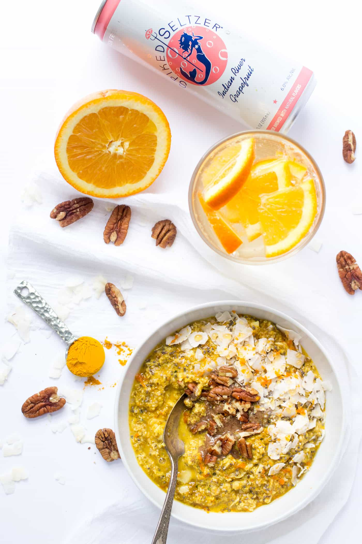The ultimate brunch -- Orange Turmeric Overnight Quinoa with a SpikedSeltzer on the side (gf + vegan)