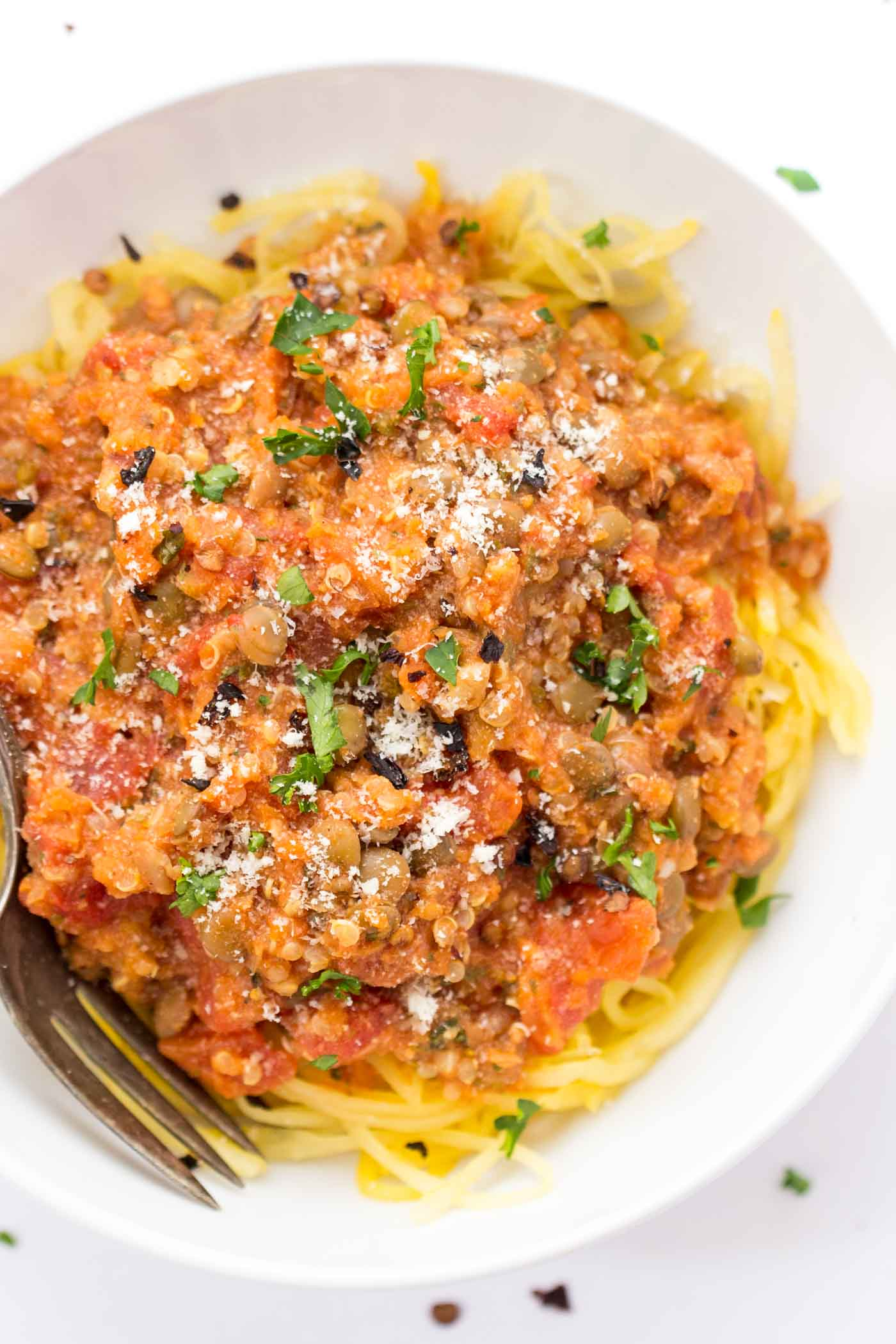 A hearty LENTIL BOLOGNESE sauce with quinoa and served over spaghetti squash -- perfect for meatless monday! [vegan + gf]