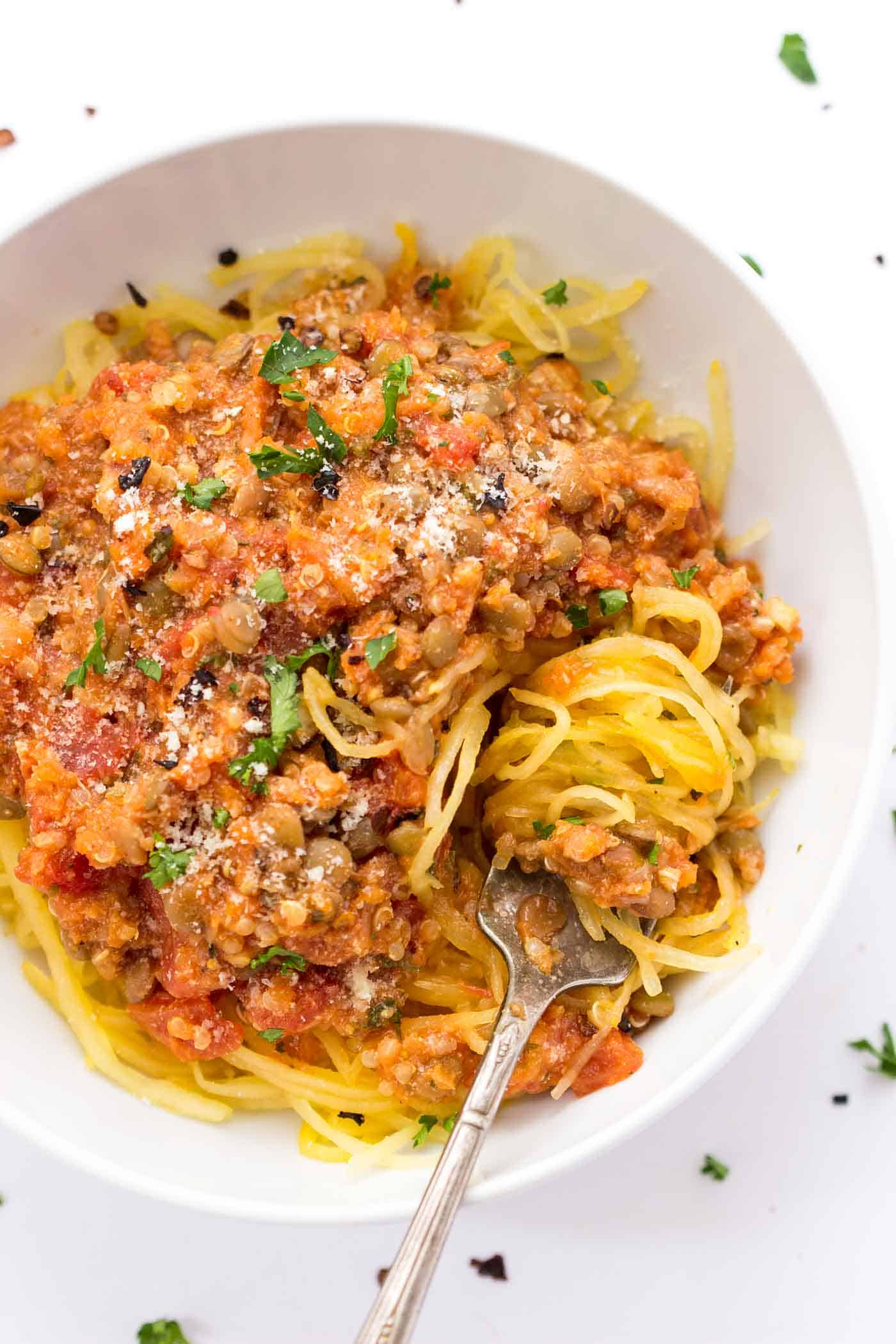 Super HEALTHY + simple lentil bolognese sauce with quinoa and served over low-cal spaghetti squash [vegan]