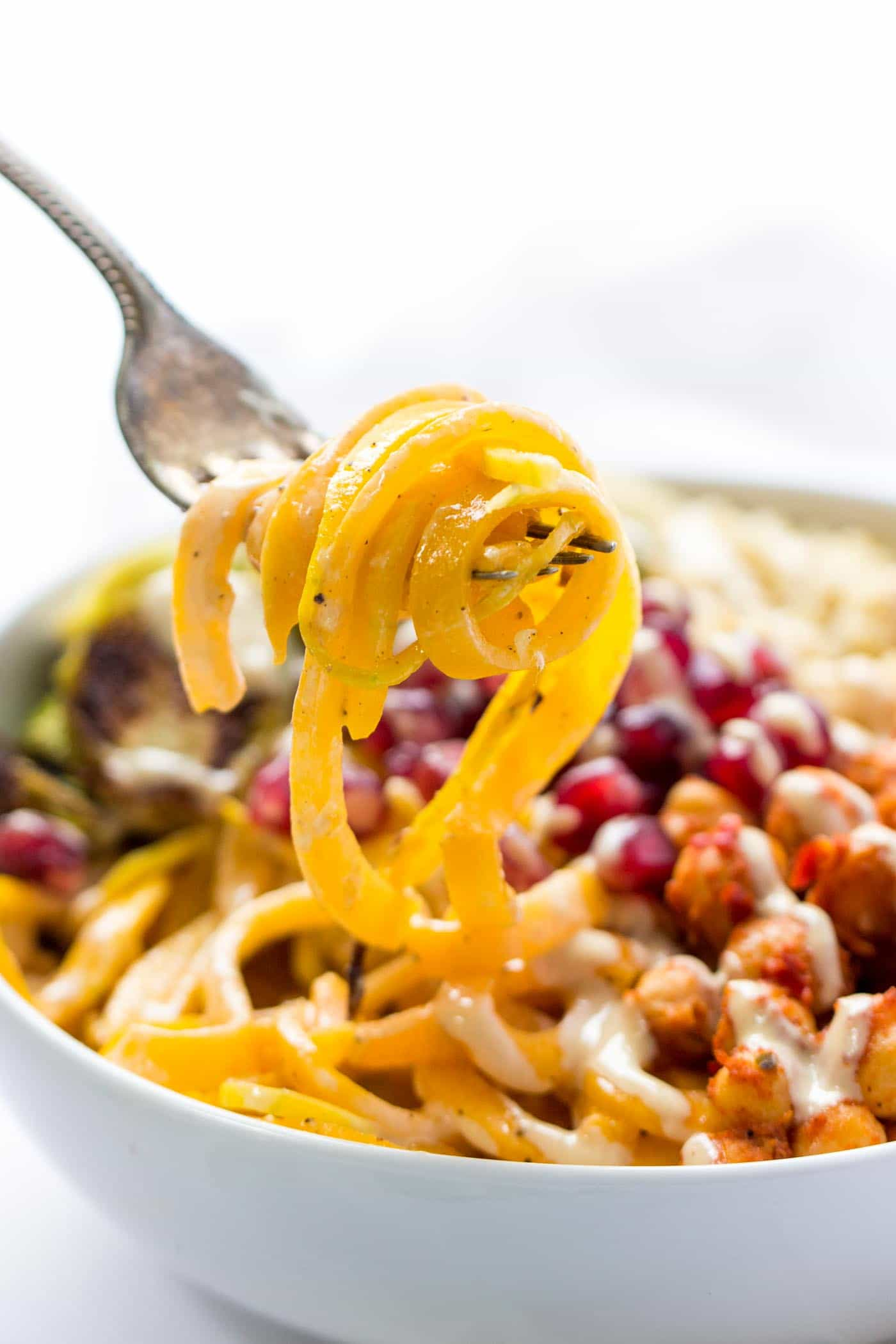 Perfect VEGAN + SPIRALIZED butternut squash noodle bowls with quinoa, brussels sprouts, pomegranates and more!
