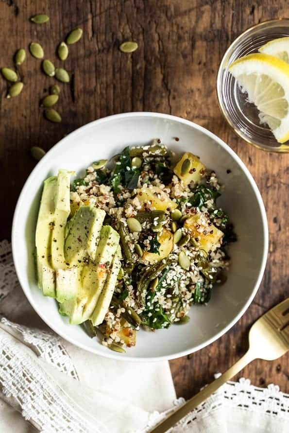 warm roasted winter quinoa salad with kale and avocado