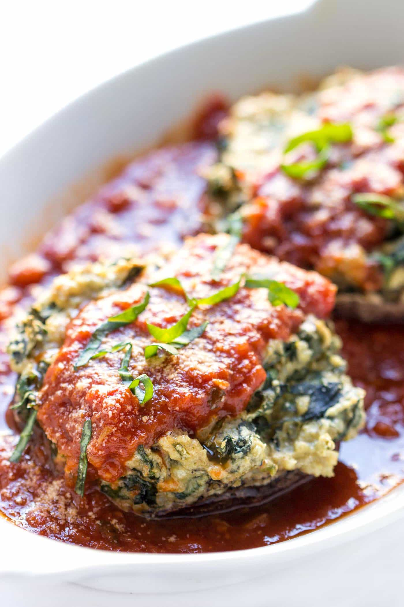 These VEGAN stuffed mushrooms are a healthier version of stuffed shells without the dairy OR gluten!