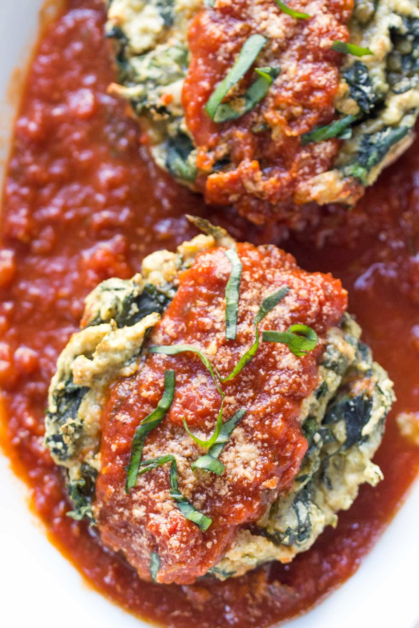 The most AMAZING vegan quinoa stuffed mushrooms with cashew ricotta and spinach -- a perfect weeknight meal for those who love Italian food but want something simple and healthy
